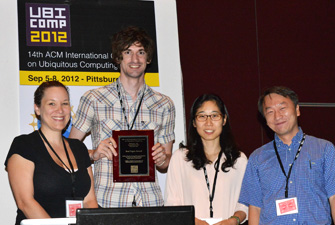 HCDE Professor Julie Kientz's graduate students Matthew Kay and Eun Kyoung Choe receive the Best Paper Award at the Ubicomp 2012 conference. From left: Program Committee Chair Gillian Hayes, UW CSE Graduate Student Matthew Kay, UW iSchool graduate student Eun Kyoung Choe, and Program Committe Chair Hao Chu. Photo: Hideyuki Tokuda