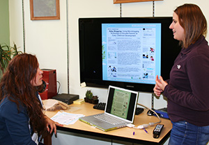 Professor Julie Kientz works with a student in her lab at the Human Centered Design and Engineering department.