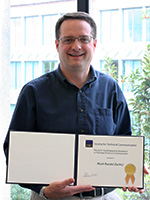 Mark Zachry with the Jay R. Gould Award for Excellence in Teaching Technical Communication.